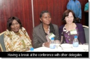 Grace (left) at the plenary session with other delegates